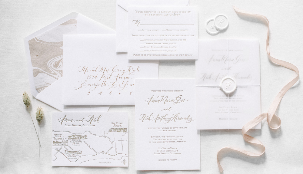 Classic calligraphy invitation suite with map and gold marble envelope liner