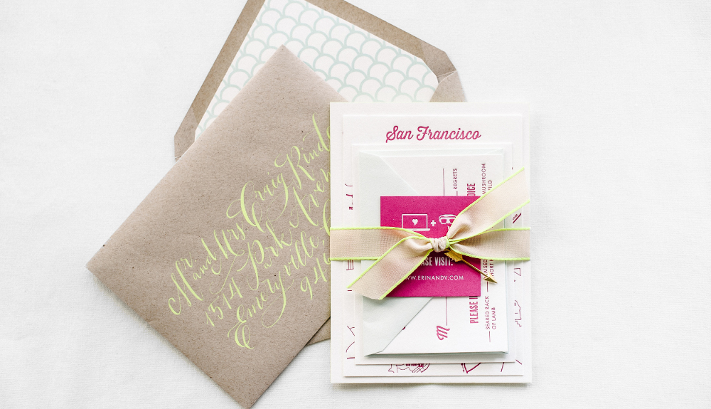 Fun and quirky custom letterpress invitation set for a tech-loving couple from San Francisco with bright calligraphy, neon accents and gold arrow charm