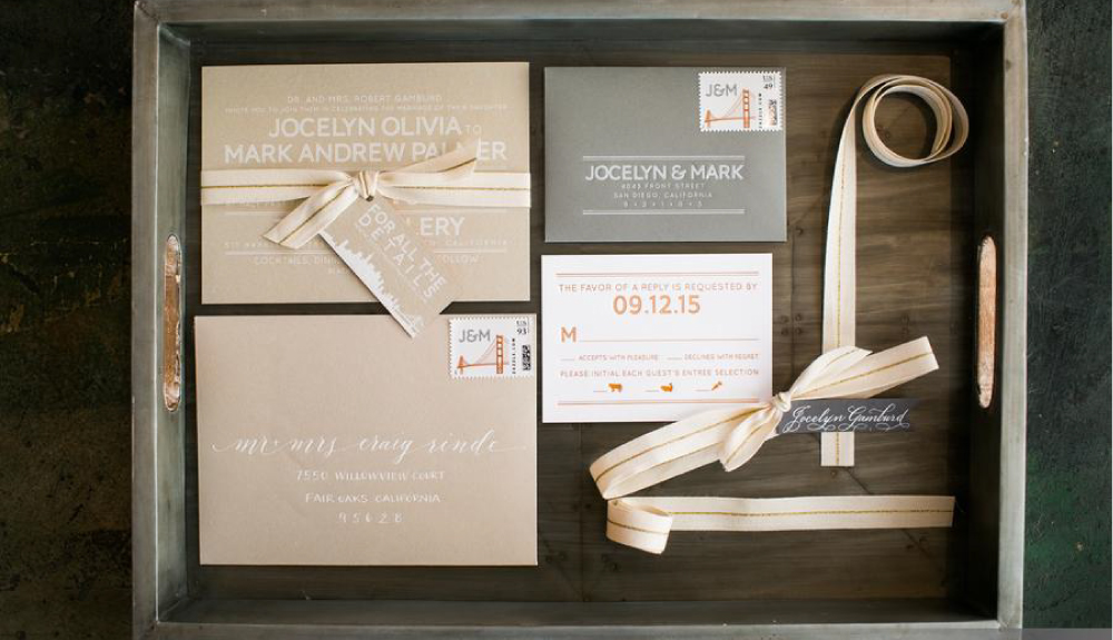 Modern, typographic, gray letterpress wedding invitations with calligraphy and custom postage