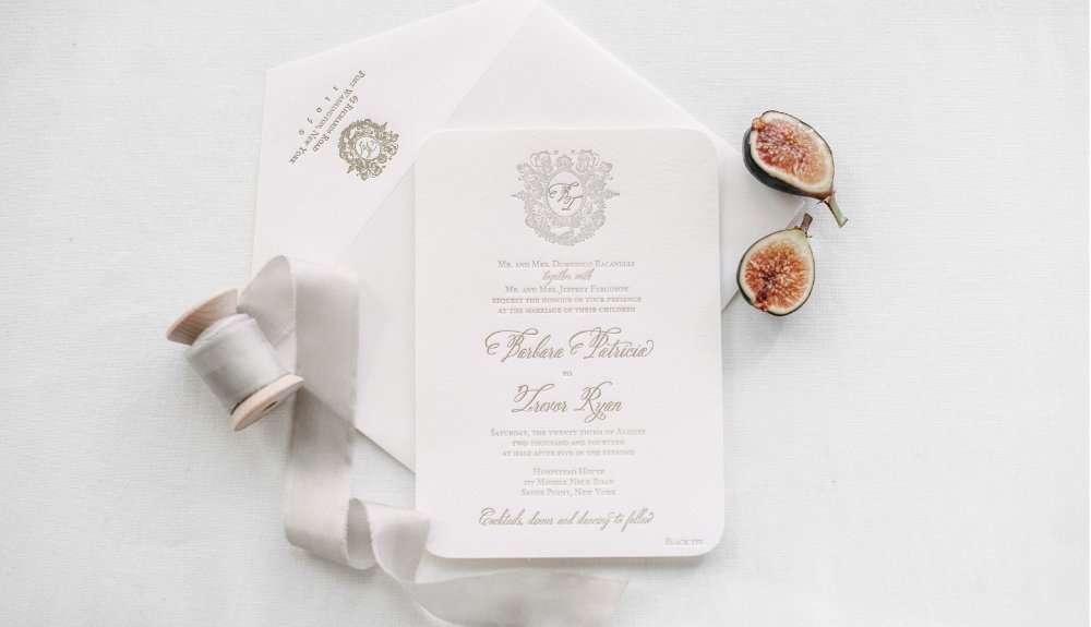 Elegant and classic monogram letterpress wedding invitation for a celebration at Hempstead House, as seen in the Knot Weddings